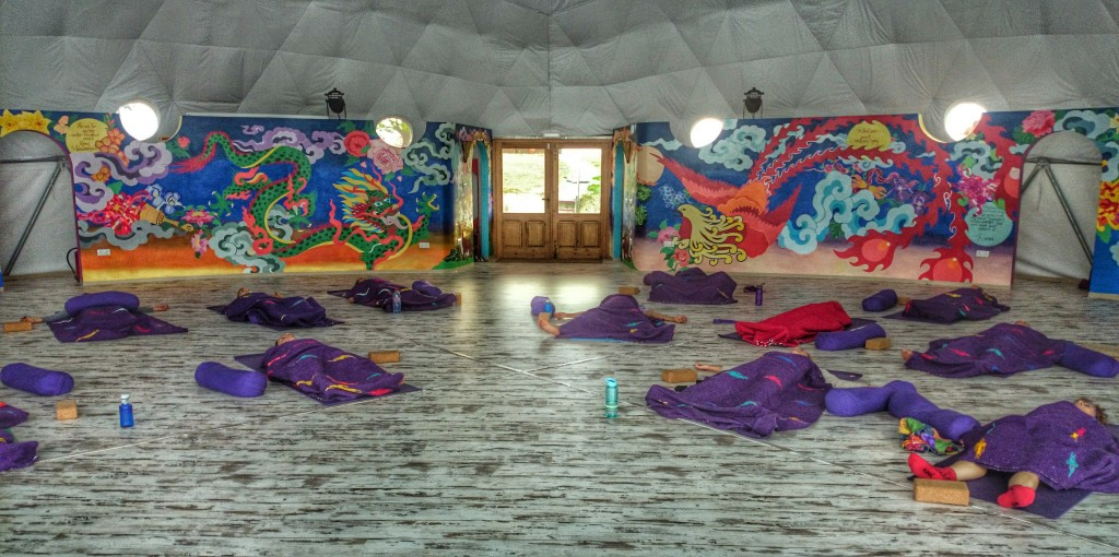 Shows yoga students lying in savsana in the Om Dome at Suryalila