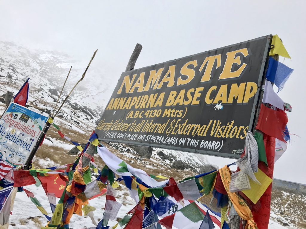Sign and prayer flags at Annapurna Base  Camp.